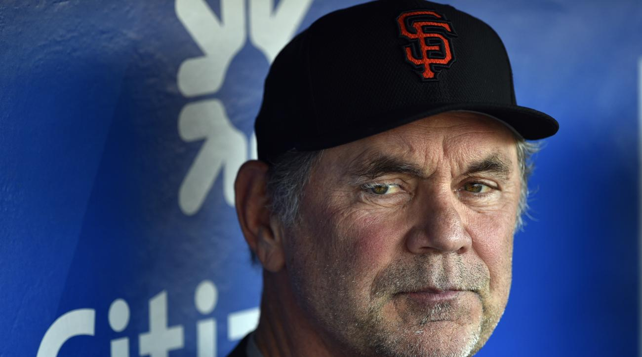 This Aug. 2, 2016 photo shows San Francisco Giants manager Bruce Bochy in the dugout prior to a baseball game against the Philadelphia Phillies in Philadelphia. Bochy has been admitted to a Miami hospital after falling ill and will miss the game against t