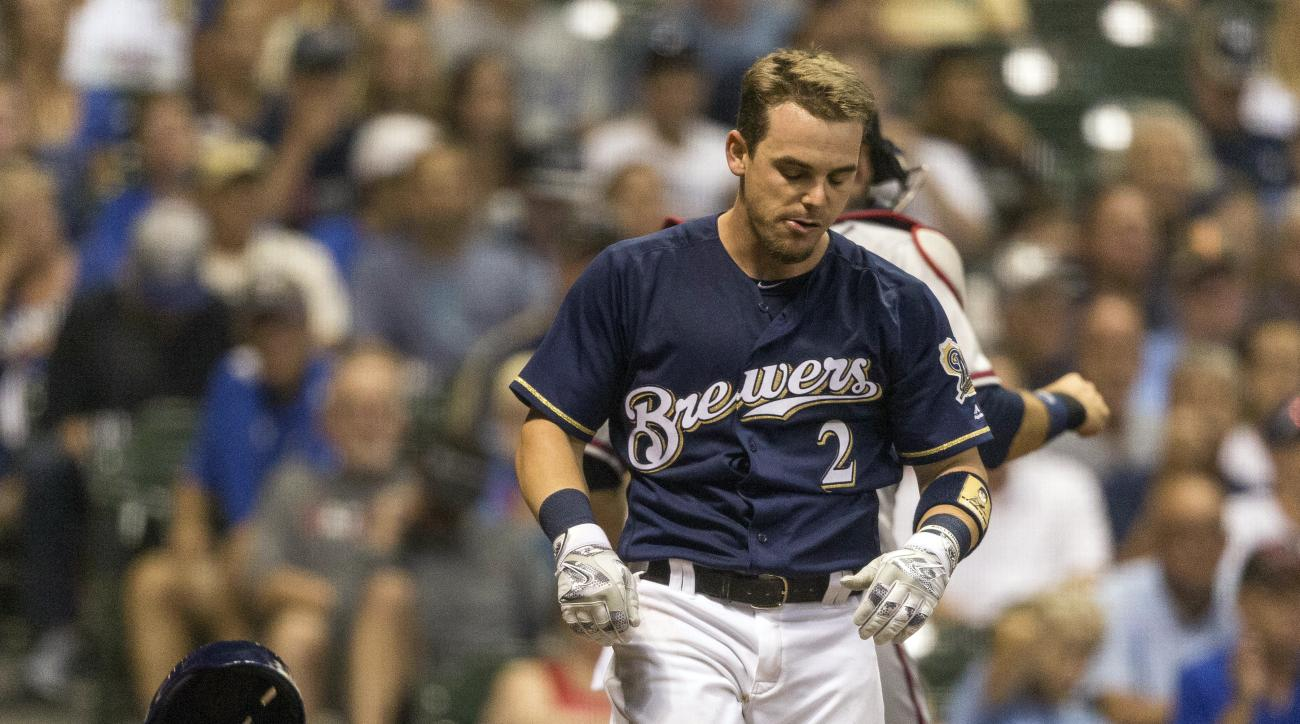 Milwaukee Brewers' Scooter Gennett slams hit helmet down after striking out with two men on base to Atlanta Braves' Jose Ramirez during the eighth inning of a baseball game, Monday, Aug. 8, 2016, in Milwaukee. (AP Photo/Tom Lynn)