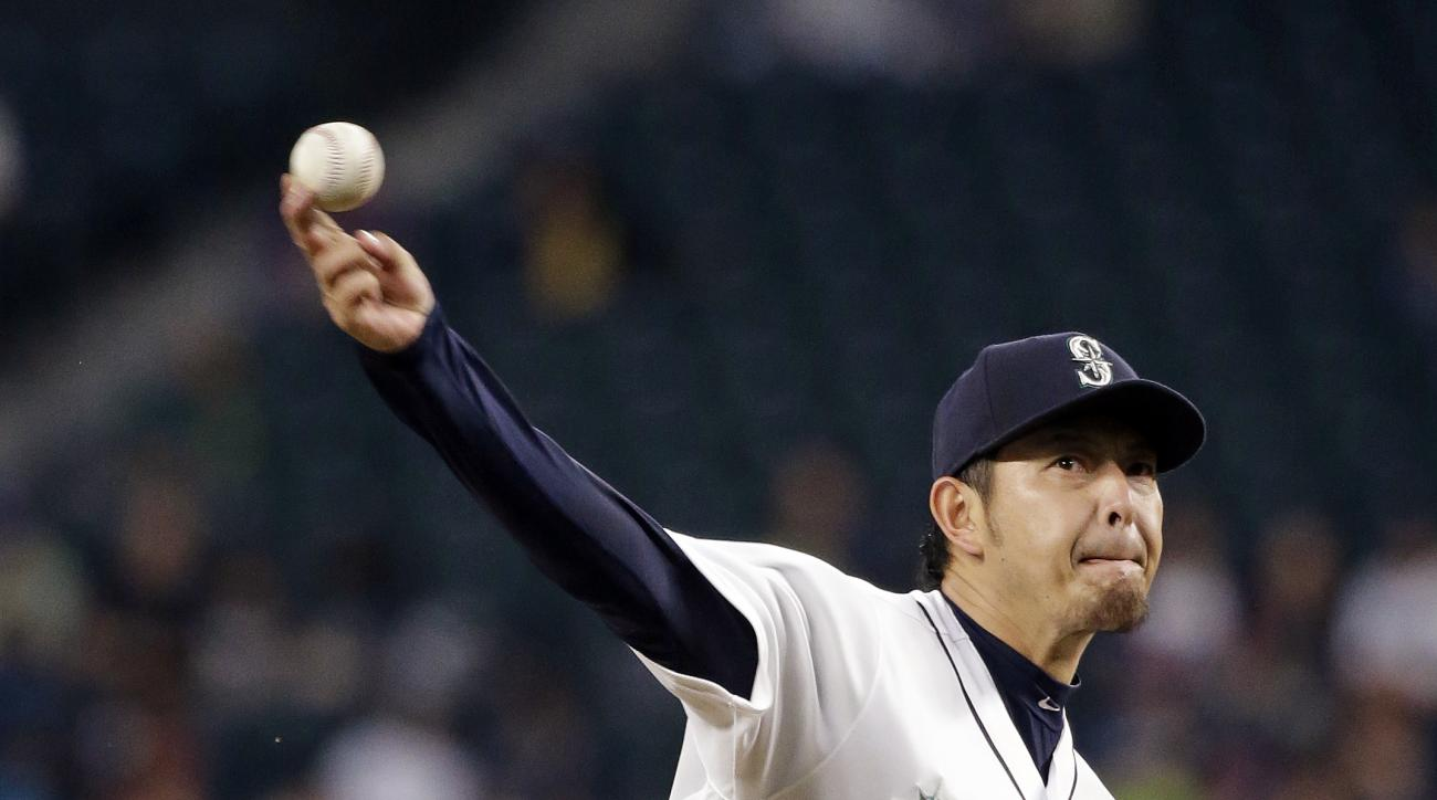 Seattle Mariners starting pitcher Hisashi Iwakuma throws against the Detroit Tigers in the fourth inning of a baseball game, Monday, Aug. 8, 2016, in Seattle. (AP Photo/Elaine Thompson)