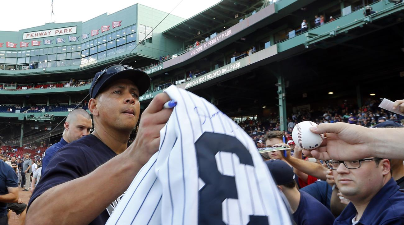 New York Yankees' Alex Rodriguez signs autographs before the team's baseball game against the Boston Red Sox at Fenway Park in Boston on Tuesday, Aug. 9, 2016. (AP Photo/Winslow Townson)