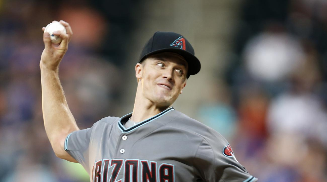 Arizona Diamondbacks starting pitcher Zack Greinke (21) winds up during the first inning of a baseball game against the New York Mets, Tuesday, Aug. 9, 2016, in New York. (AP Photo/Kathy Willens)