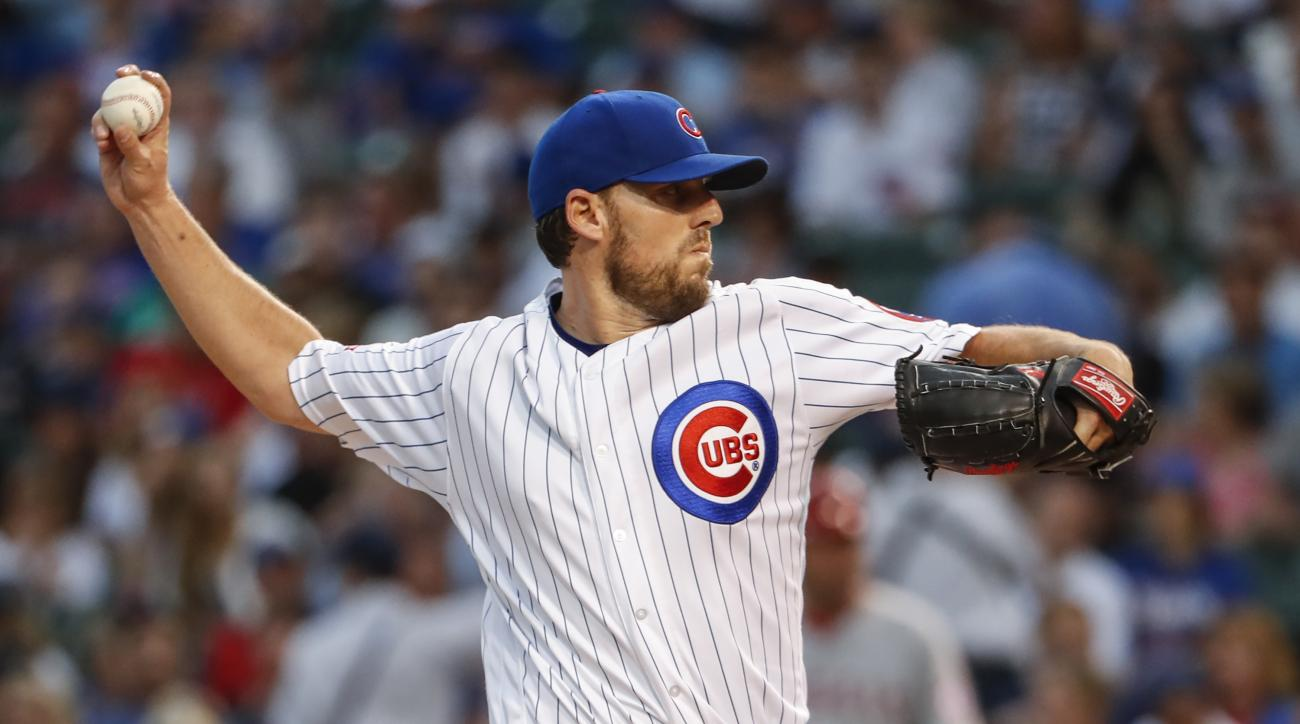 Chicago Cubs starting pitcher John Lackey works against the Los Angeles Angels during the first inning of a baseball game Tuesday, Aug. 9, 2016, at Wrigley Field in Chicago. (AP Photo/Kamil Krzaczynski)