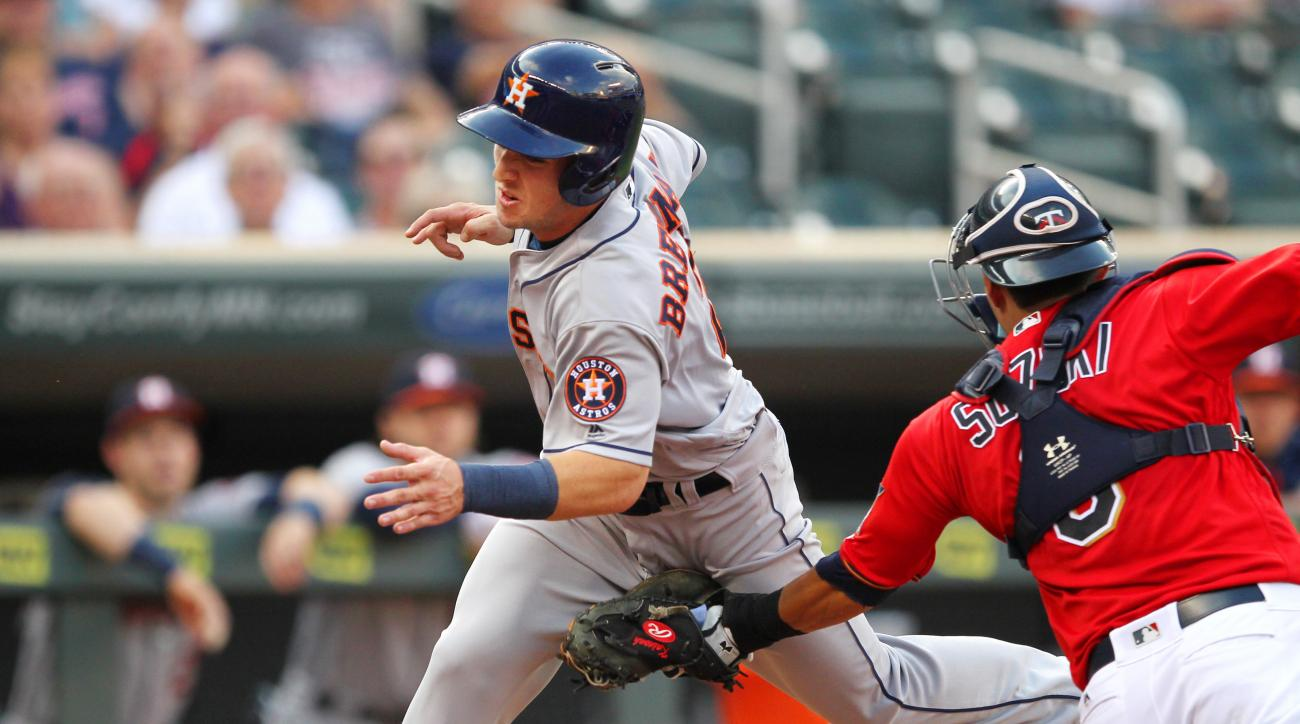 Houston Astros' Alex Bergman, left, is tagged out at the plate by Minnesota Twin catcher Kurt Suzuki during the first inning during a baseball game on Tuesday, Aug., 9, 2016 in Minneapolis.(AP Photo/Andy Clayton-King)