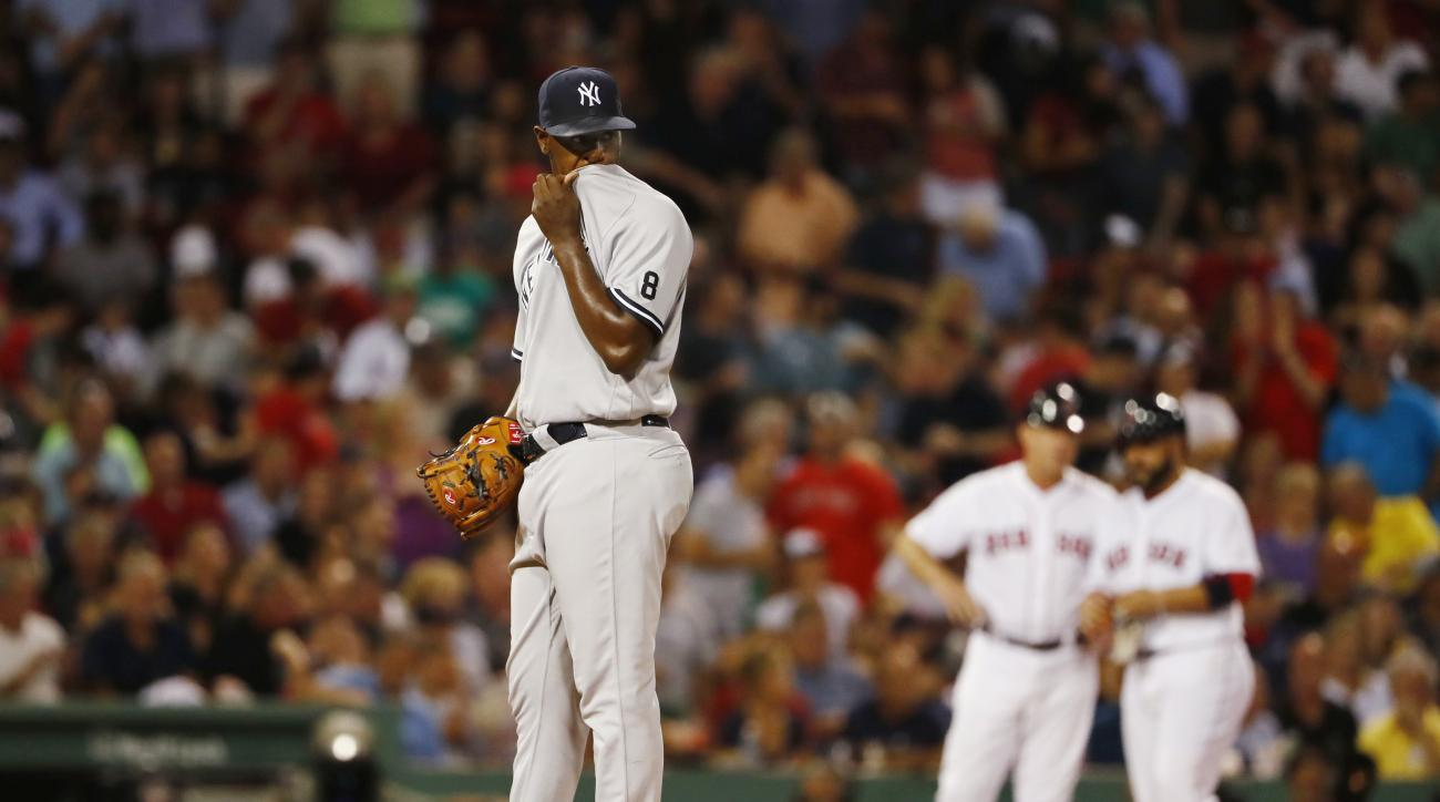 New York Yankees starting pitcher Luis Severino wipes his face after giving up a triple to Boston Red Sox's Sandy Leon, right, during the fifth inning of a baseball game at Fenway Park in Boston on Tuesday, Aug. 9, 2016. (AP Photo/Winslow Townson)