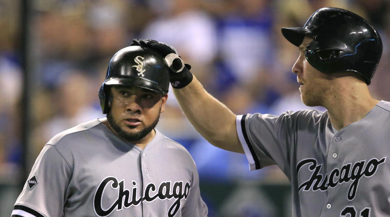 Chicago White Sox left fielder Melky Cabrera (53) is congratulated by teammate Todd Frazier (21) after scoring on a single by Jose Abreu during the fifth inning of a baseball game against the Kansas City Royals at Kauffman Stadium in Kansas City, Mo., Tue