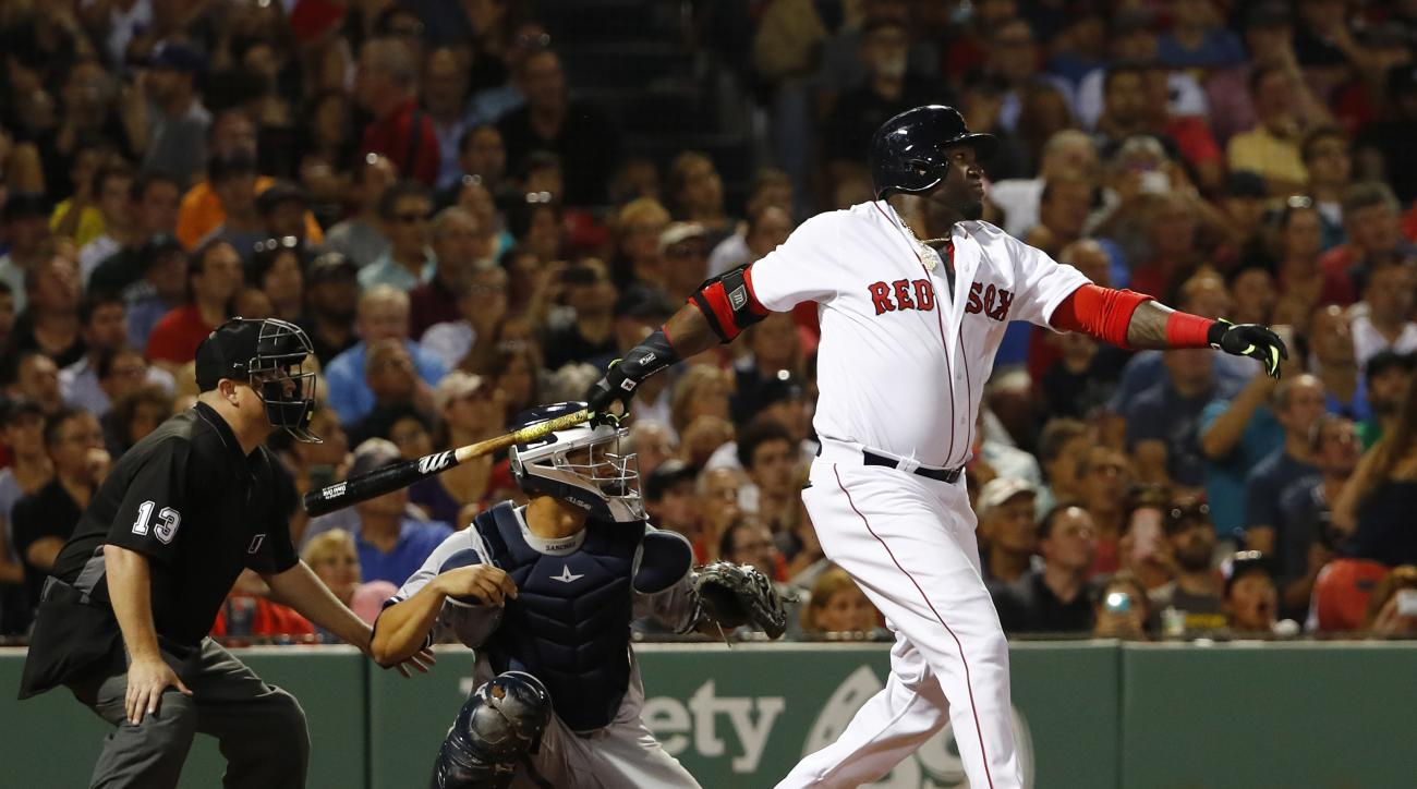 Boston Red Sox designated hitter David Ortiz watches his RBI single against the New York Yankees during the fifth inning of a baseball game at Fenway Park in Boston on Tuesday, Aug. 9, 2016. (AP Photo/Winslow Townson)