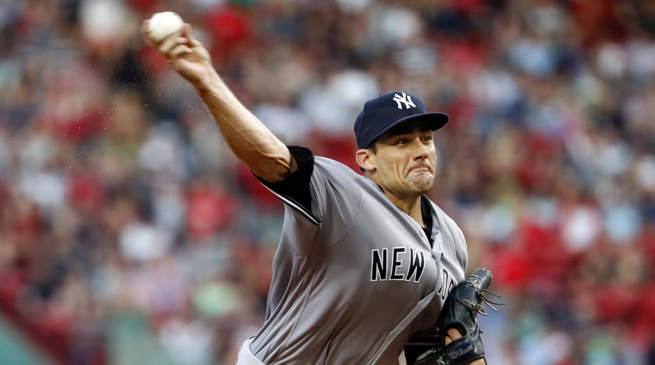 New York Yankees starting pitcher Nathan Eovaldi delivers a pitch against the Boston Red Sox during the first inning of a baseball game at Fenway Park in Boston Wednesday, Aug. 10, 2016. (AP Photo/Winslow Townson)