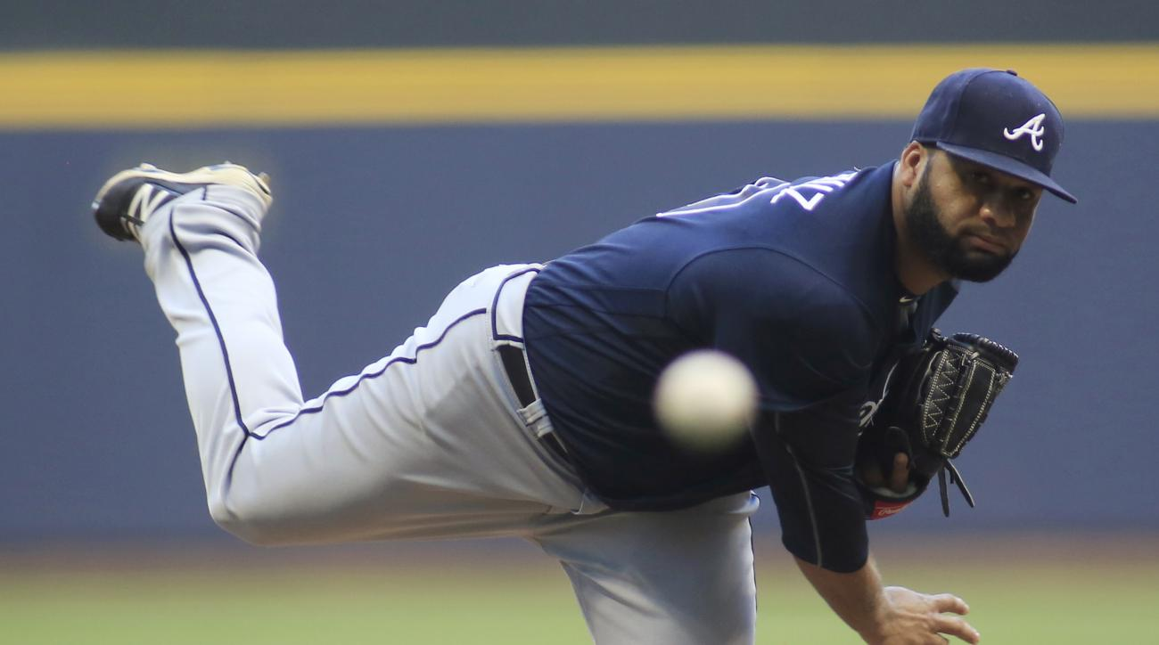 Atlanta Braves pitcher Joel De La Cruz throws to a Milwaukee Brewers batter during the first inning of a baseball game Wednesday, Aug. 10, 2016, in Milwaukee. (AP Photo/Darren Hauck)