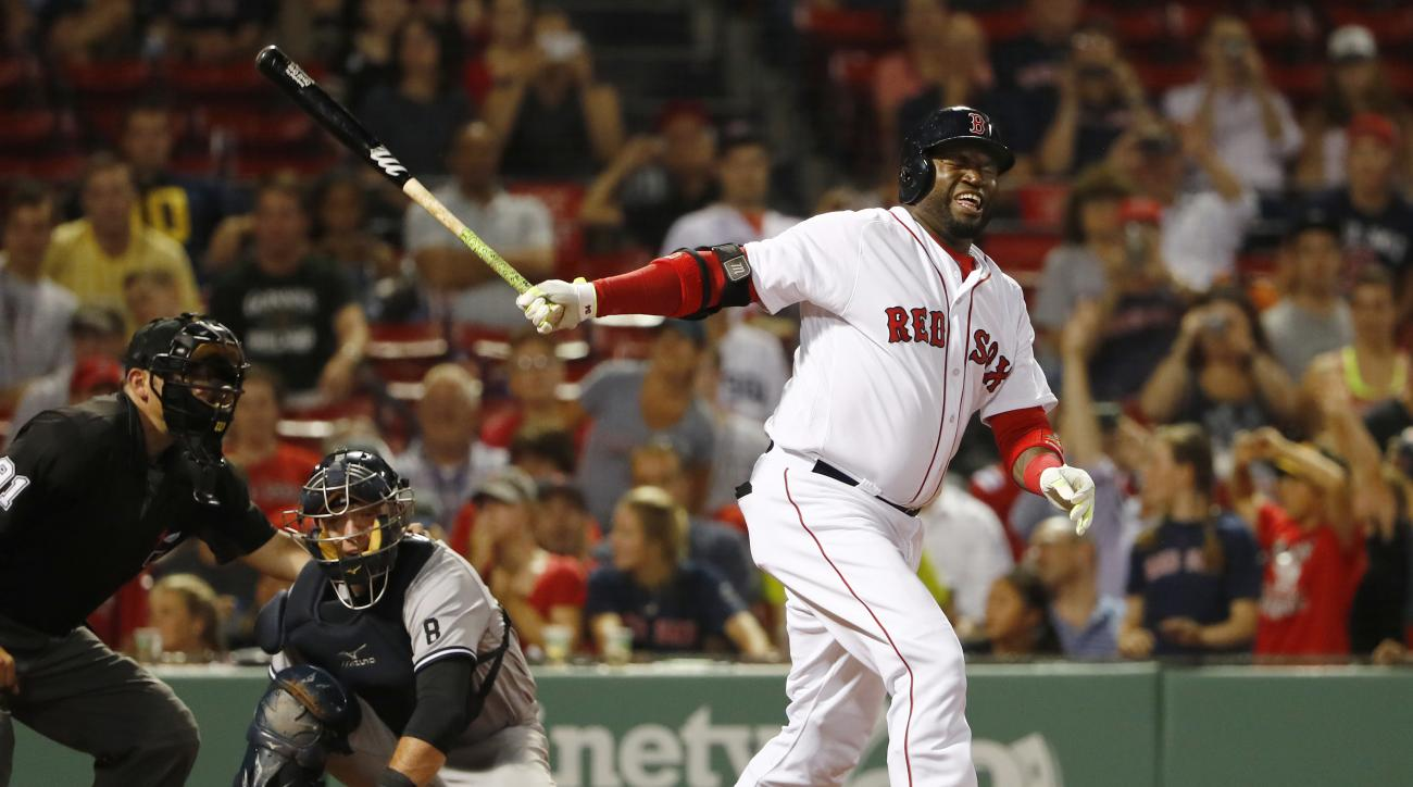 Boston Red Sox designated hitter David Ortiz grimaces after fouling a ball off himself during the ninth inning of their 9-4 loss to the New York Yankees in a baseball game at Fenway Park in Boston Wednesday, Aug. 10, 2016. (AP Photo/Winslow Townson)