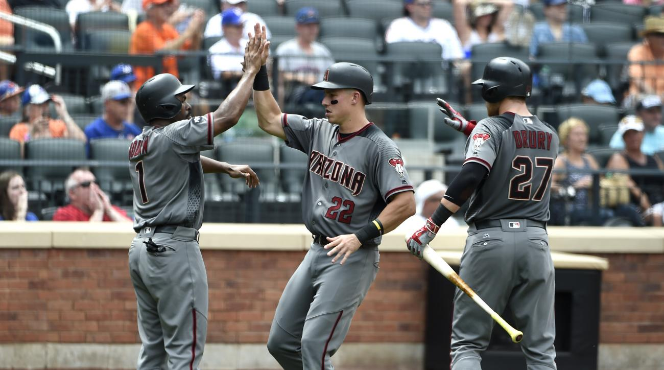 Arizona Diamondbacks' Michael Bourn (1), Jake Lamb (22) and Brandon Drury (27) high-five at home plate after Bourn and Lamb scored on an RBI by Chris Owings off of New York Mets relief pitcher Jonathon Niese in the sixth inning of a baseball game, Thursda