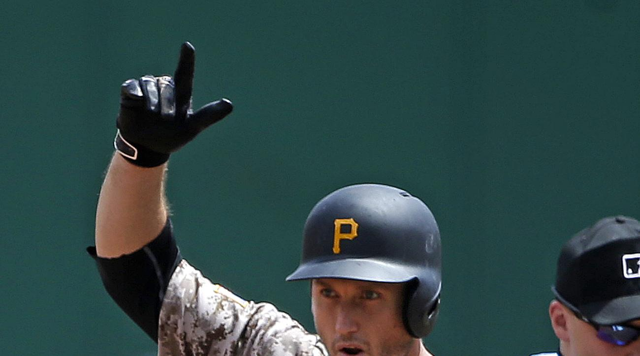 Pittsburgh Pirates' David Freese celebrates as he stands on second base after driving in a run with a double off San Diego Padres starting pitcher Christian Friedrich in the third inning of a baseball game in Pittsburgh, Thursday, Aug. 11, 2016. (AP Photo