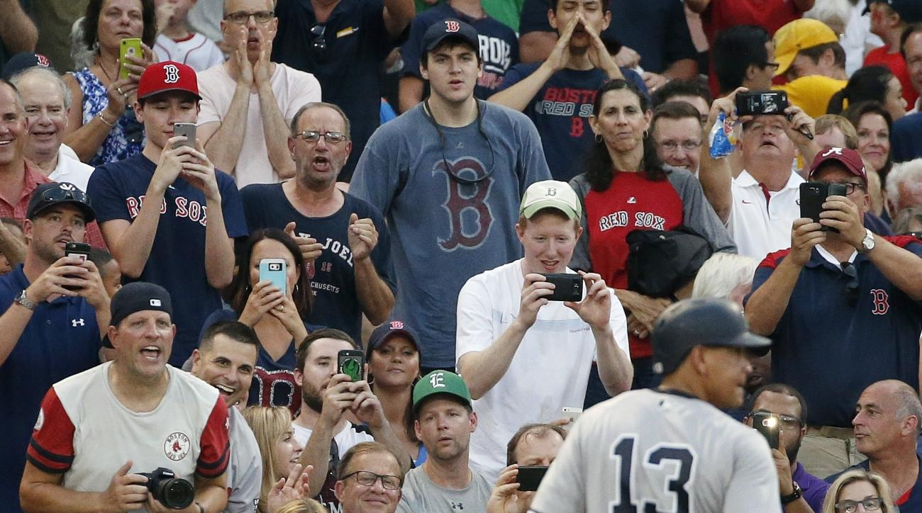 Fans react as New York Yankees' Alex Rodriguez (13) walks to the dugout after lining out during the second inning of a baseball game against the Boston Red Sox in Boston, Thursday, Aug. 11, 2016. (AP Photo/Michael Dwyer)