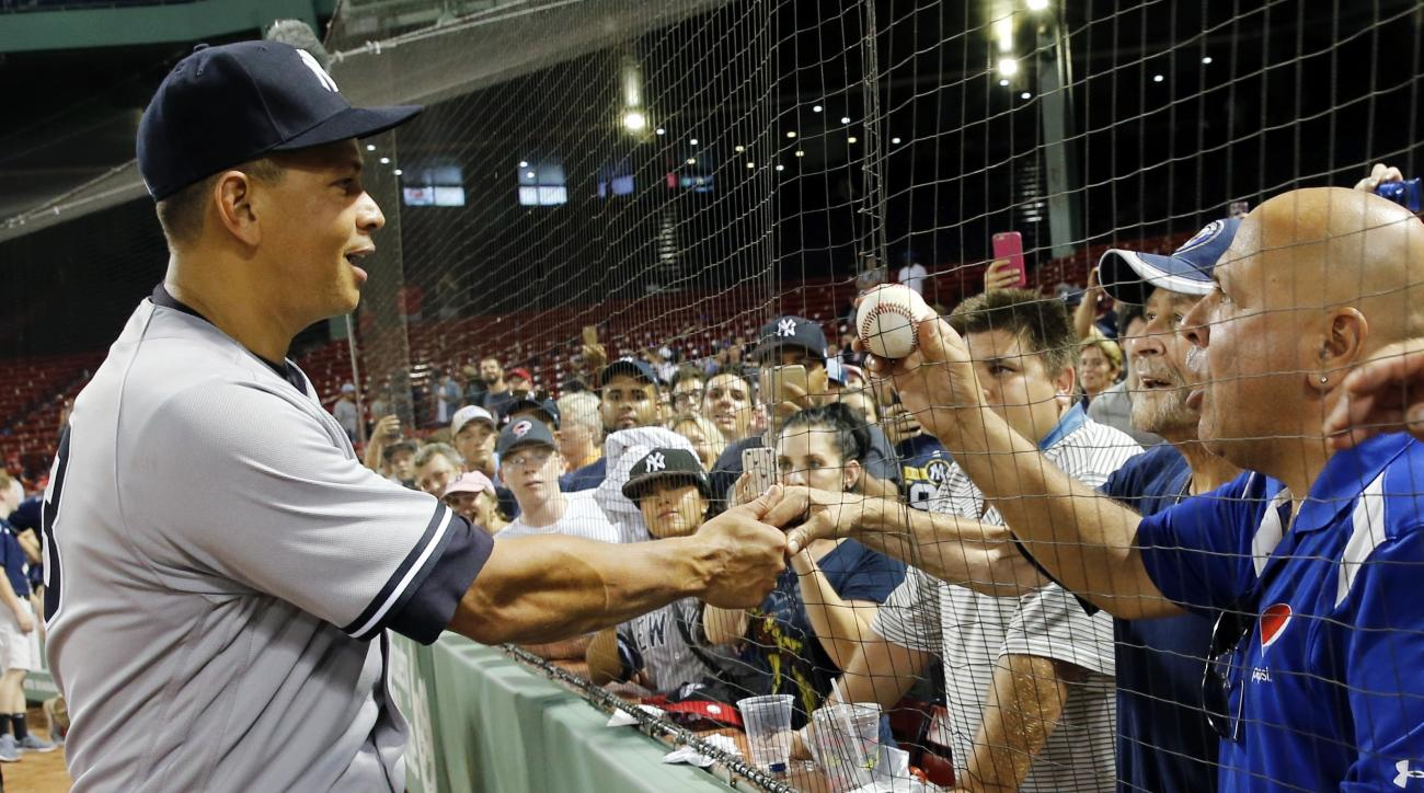 New York Yankees' Alex Rodriguez greets fans following the Yankees' baseball game against the Boston Red Sox in Boston, Thursday, Aug. 11, 2016. The Yankees won 4-2. (AP Photo/Michael Dwyer)