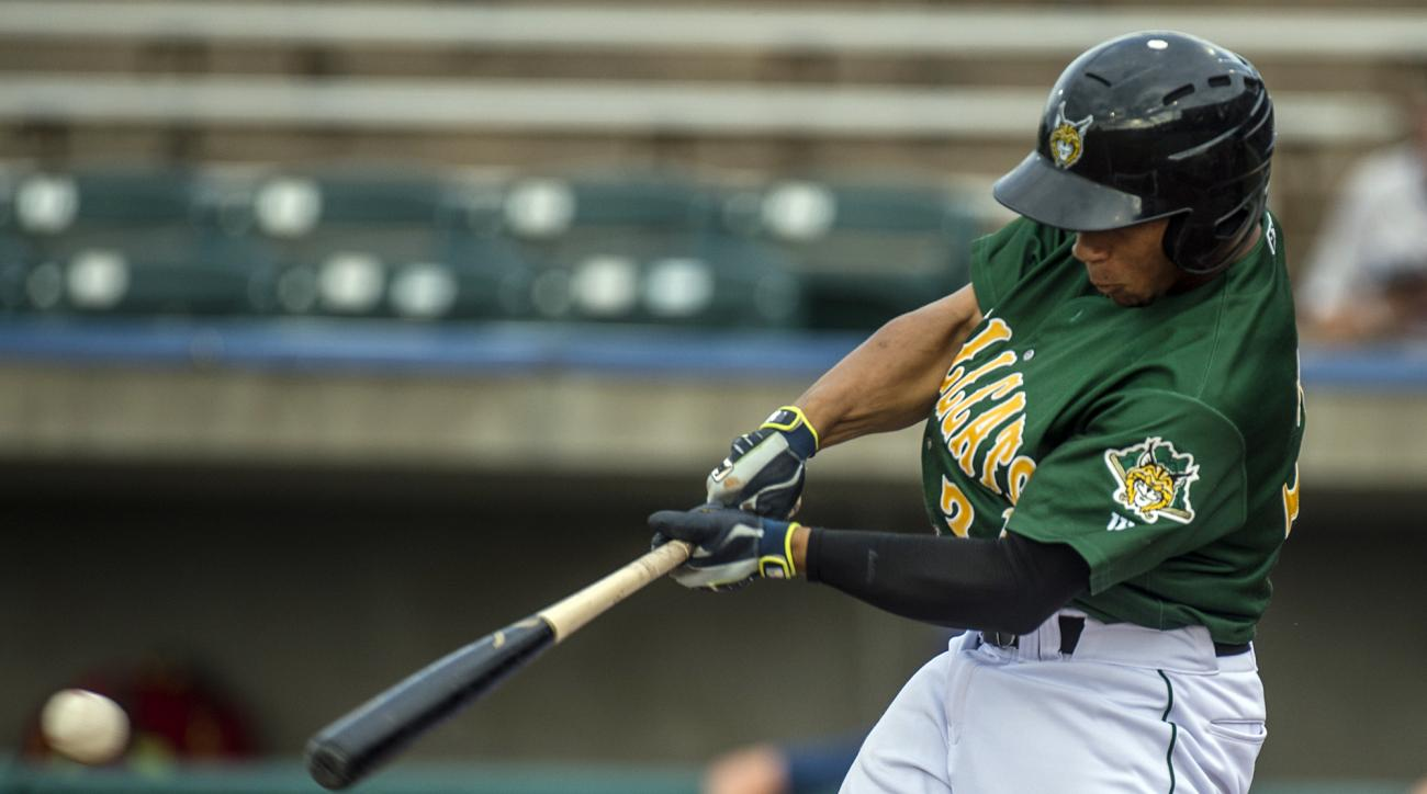In this Monday, Aug, 1, 2016, photo, Lynchburg Hillcats' Francisco Mejia hits a single, extending his hitting streak to 43 games, during the first inning of a minor league baseball against the Potomac Nationals in Lynchburg, Va. The Cleveland Indians catc