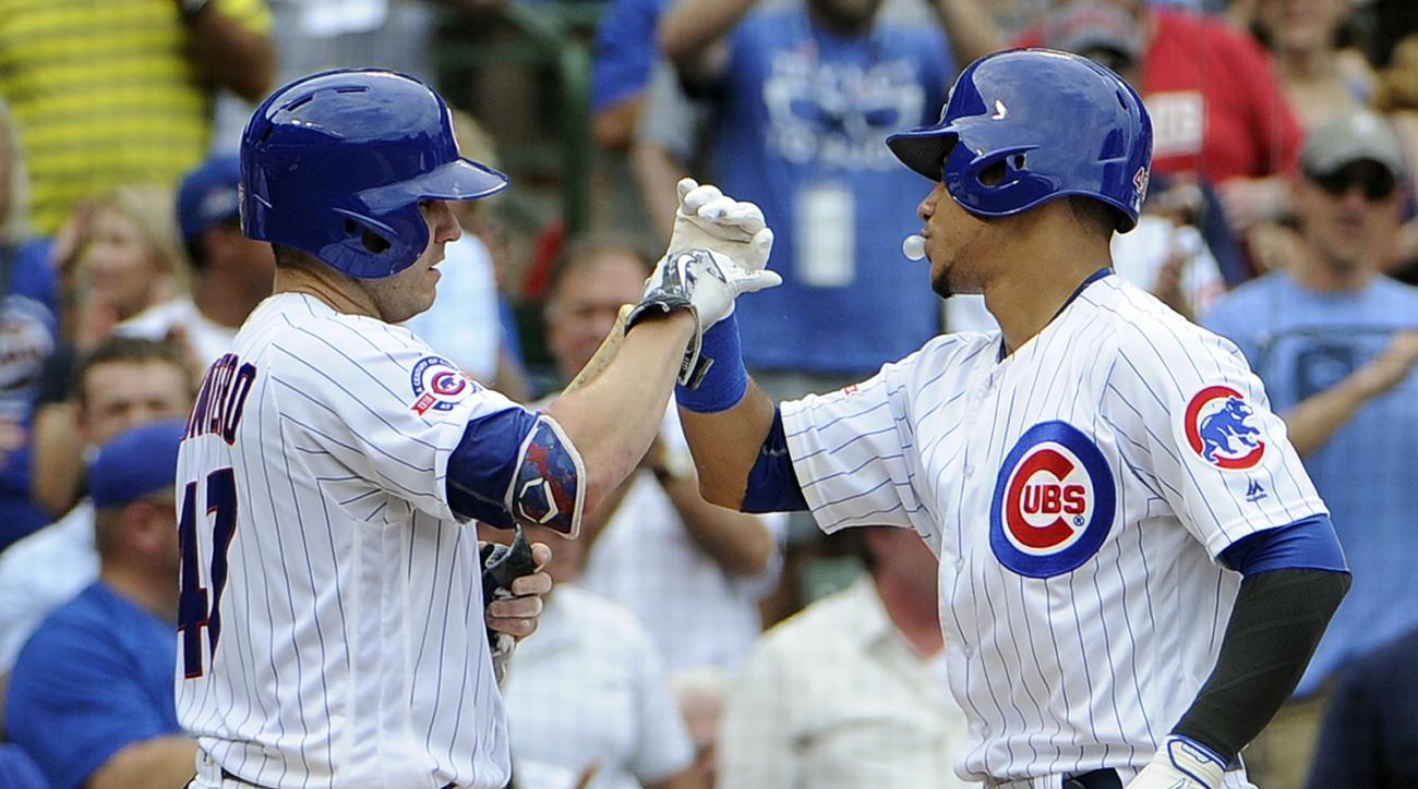 Chicago Cubs' Willson Contreras, right, is greeted by Miguel Montero, left, after hitting a three-run hom run against the St. Louis Cardinals during the second inning of a baseball game, Friday, Aug. 12, 2016, in Chicago. (AP Photo/David Banks)