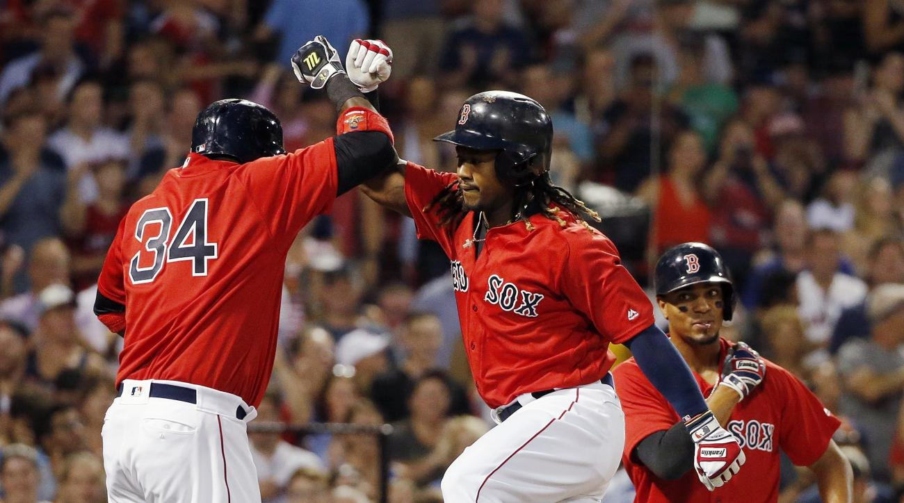 Boston Red Sox's Hanley Ramirez, center, celebrates his three-run home run that scored David Ortiz (34) and Xander Bogaerts, right, during the second inning of a baseball game against the Arizona Diamondbacks in Boston, Friday, Aug. 12, 2016. (AP Photo/Mi