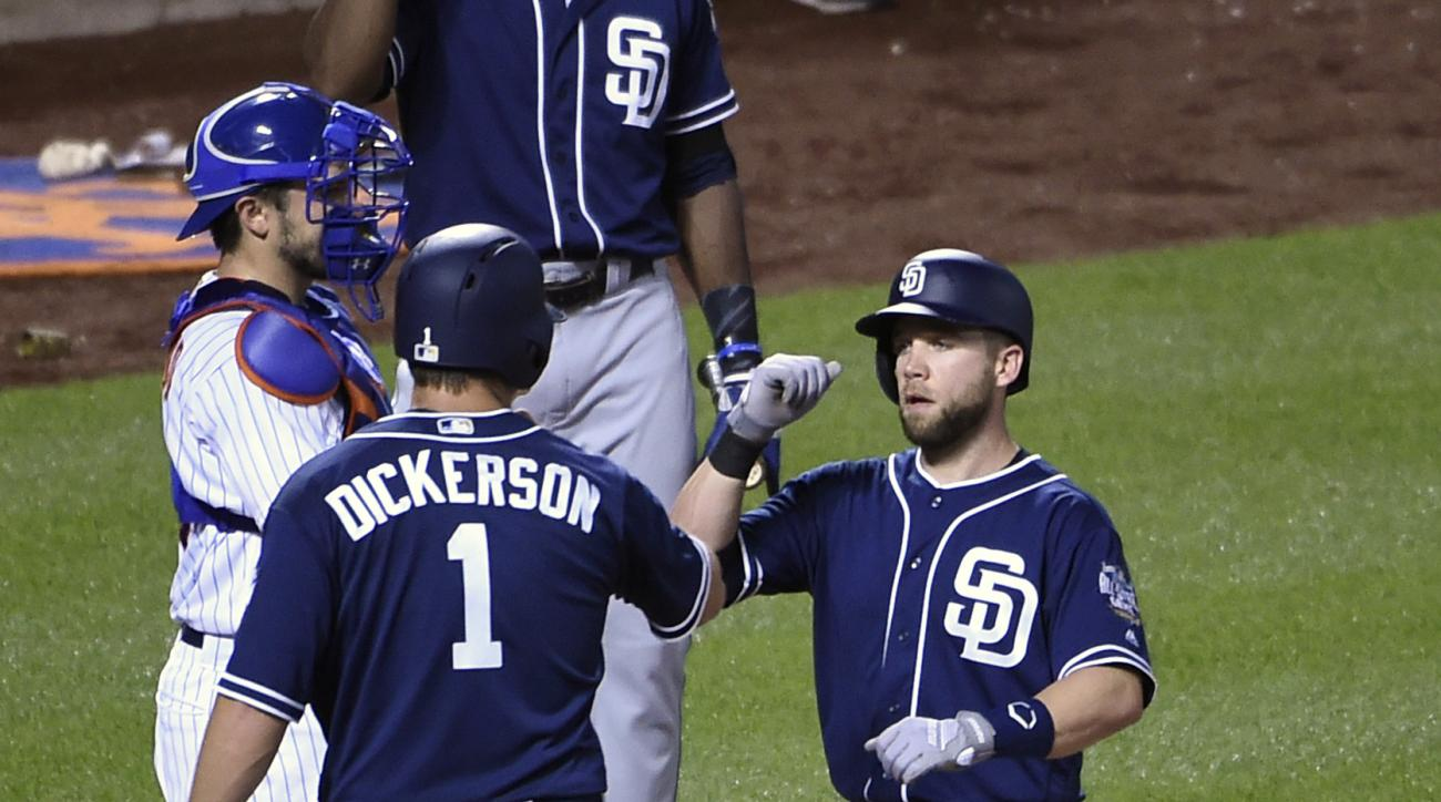 San Diego Padres Ryan Schimpf, right, is greeted at home plate by Alex Dickerson (1) in front of New York Mets catcher Travis d'Arnaud after hitting a two-run home run off Mets starting pitcher Logan Verrett that also scored Dickerson in the third inning