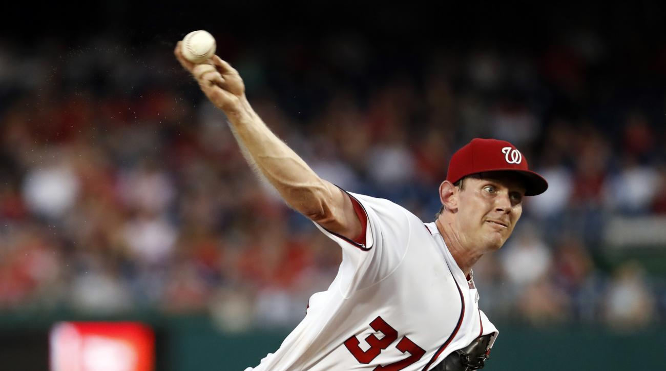Washington Nationals starting pitcher Stephen Strasburg throws during the third inning of a baseball game against the Atlanta Braves at Nationals Park, Friday, Aug. 12, 2016, in Washington. (AP Photo/Alex Brandon)