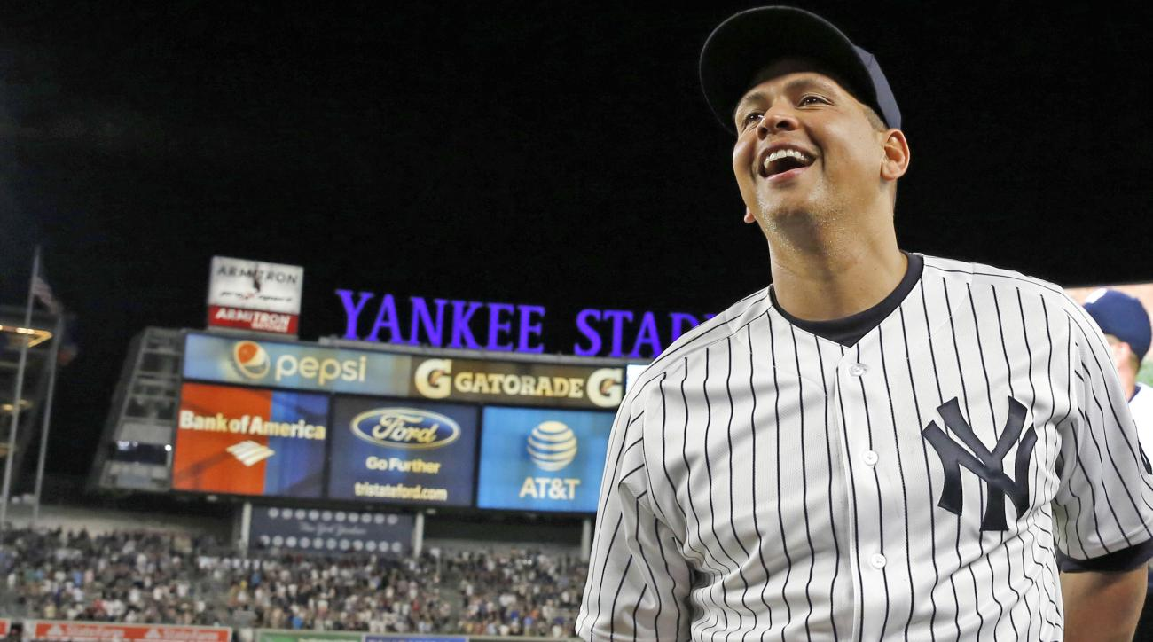 New York Yankees' Alex Rodriguez holds a baseball as he laughs during an interview following his final baseball game as a Yankee player, against the Tampa Bay Rays at Yankee Stadium in New York, Friday, Aug. 12, 2016. The Yankees won 6-3.(AP Photo/Kathy W