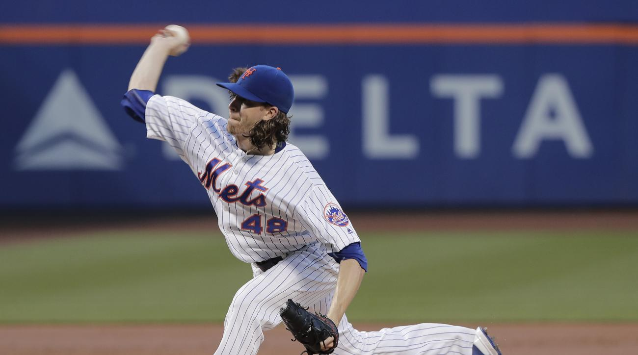 New York Mets starting pitcher Jacob deGrom (48) delivers against the San Diego Padres during the second inning of a baseball game, Saturday, Aug. 13, 2016, in New York. (AP Photo/Julie Jacobson)