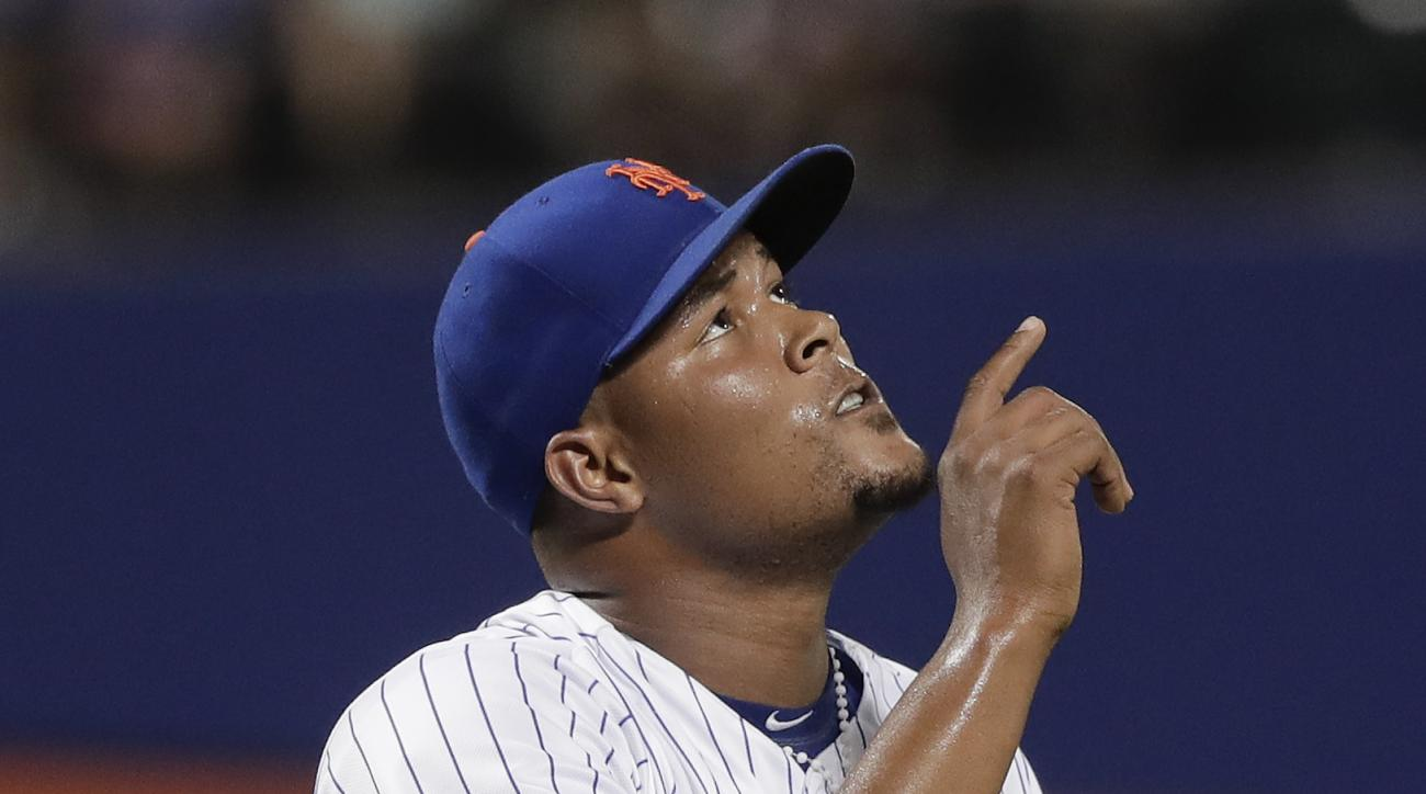 New York Mets relief pitcher Jeurys Familia (27) gestures as he walks off the field at the end of the top of the ninth inning of a baseball game against the San Diego Padres, Saturday, Aug. 13, 2016, in New York. (AP Photo/Julie Jacobson)