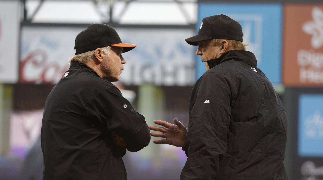 Baltimore Orioles manager Buck Showalter, left, talks with first base umpire Jeff Kellogg, right, after the Orioles' Adam Jones grounded out to San Francisco Giants starting pitcher Madison Bumgarner in the sixth inning of a baseball game Saturday, Aug. 1