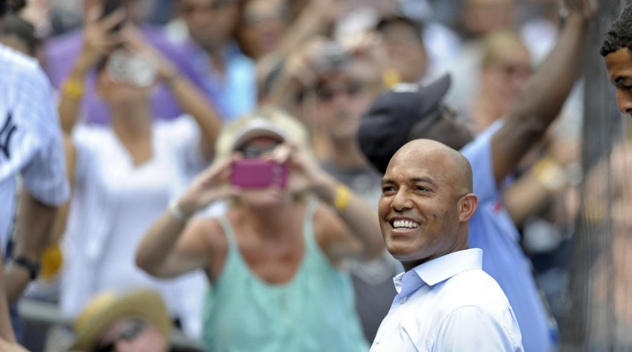 Former New York Yankees closer Mariano Rivera smiles as he leaves the field after he unveiled his Monument Park plaque before a baseball game Sunday, Aug. 14, 2016, at Yankee Stadium in New York. (AP Photo/Bill Kostroun)