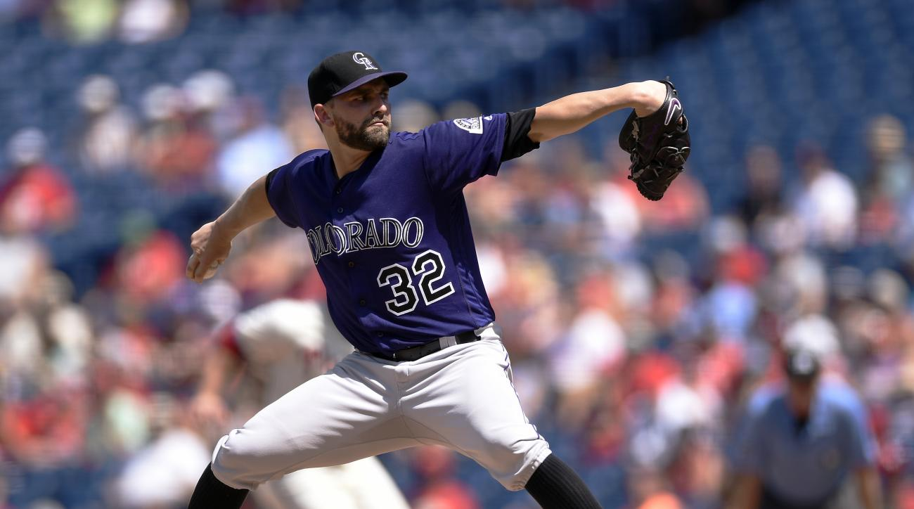 Colorado Rockies starting pitcher Tyler Chatwood throws during the first inning of a baseball game against the Philadelphia Phillies on Sunday, Aug. 14, 2016, in Philadelphia. (AP Photo/Michael Perez)