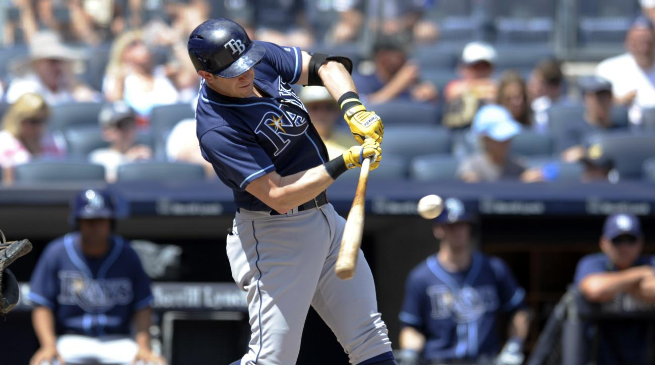 Tampa Bay Rays' Evan Longoria hits an RBI double during the first inning of a baseball game against the New York Yankees on Sunday, Aug.14, 2016, at Yankee Stadium in New York. (AP Photo/Bill Kostroun)