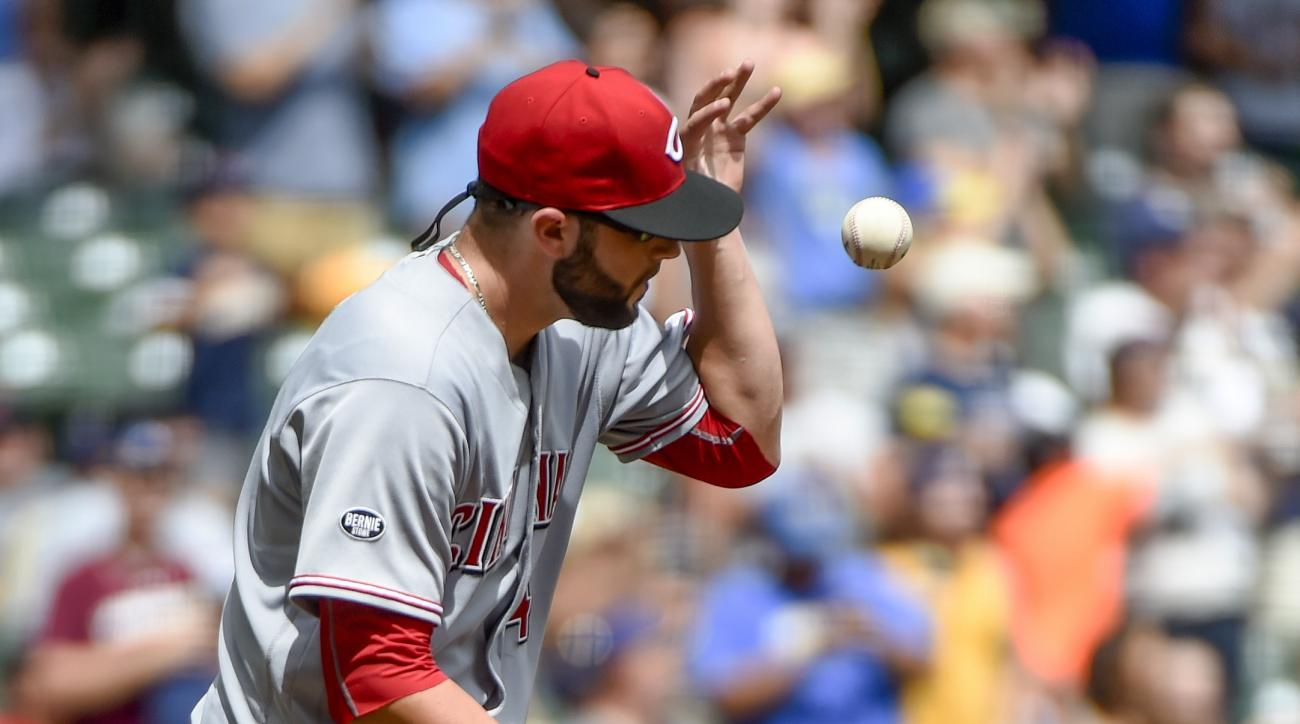 Cincinnati Reds pitcher Cody Reed reacts after giving up a three-run home run to Milwaukee Brewers' Ryan Braun during the second inning of a baseball game Sunday, Aug. 14, 2016, in Milwaukee. (AP Photo/Benny Sieu)