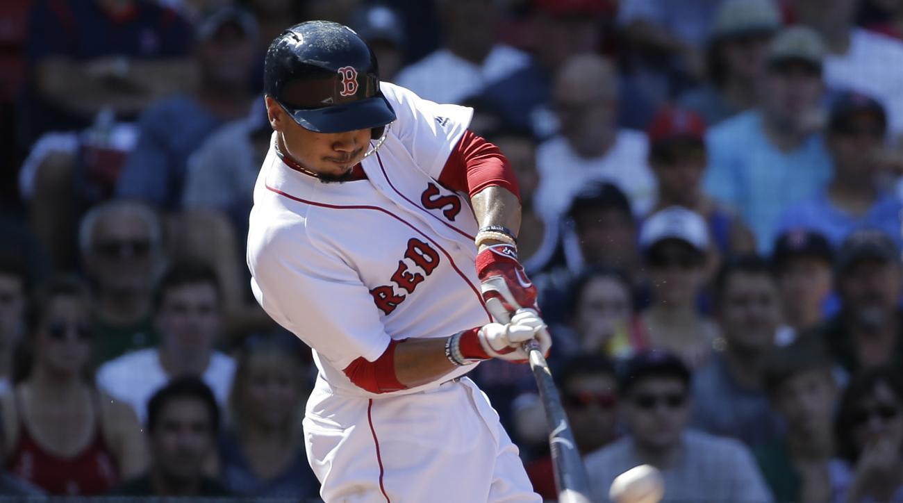 Boston Red Sox's Mookie Betts hits a three-run home run off a pitch by Arizona Diamondbacks' Adam Loewen in the fifth inning of a baseball game, Sunday, Aug. 14, 2016, in Boston. (AP Photo/Steven Senne)