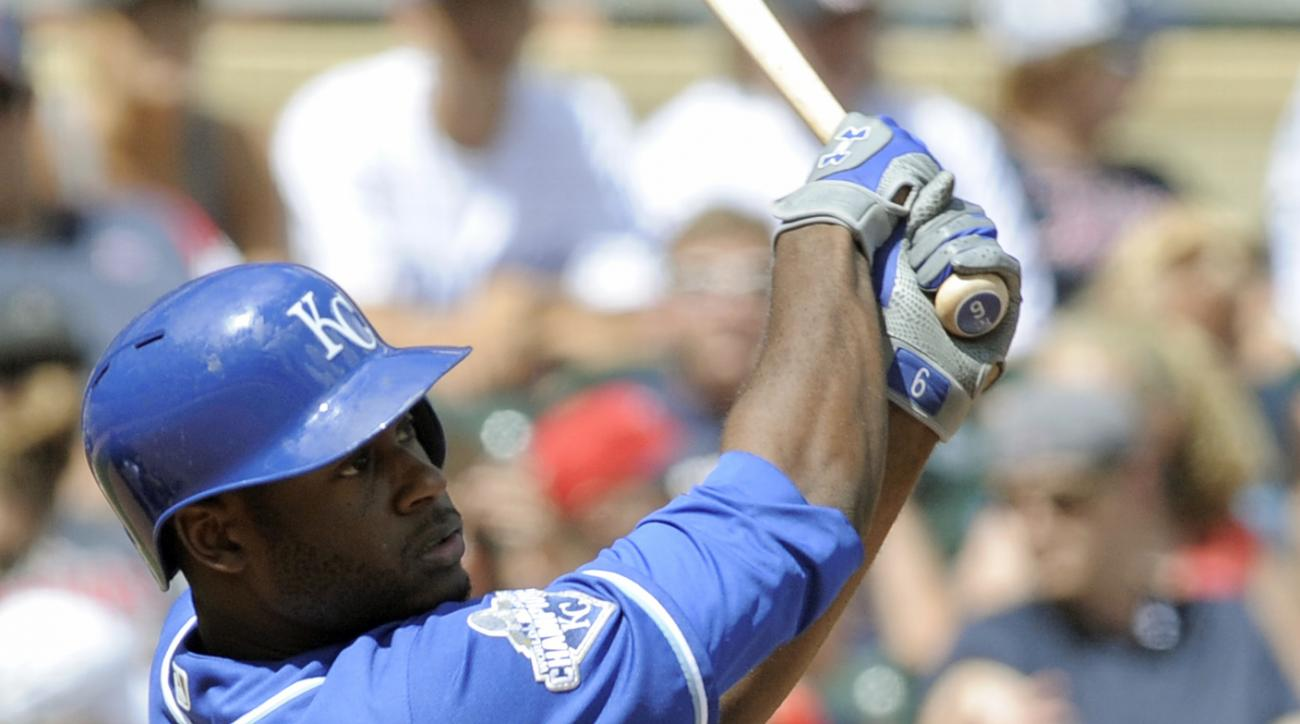Kansas City Royals' Lorenzo Cain follows through with a double off Minnesota Twins pitcher Hector Santiago during the fourth inning of a baseball game, Sunday, Aug. 14, 2016, in Minneapolis. (AP Photo/Tom Olmscheid)