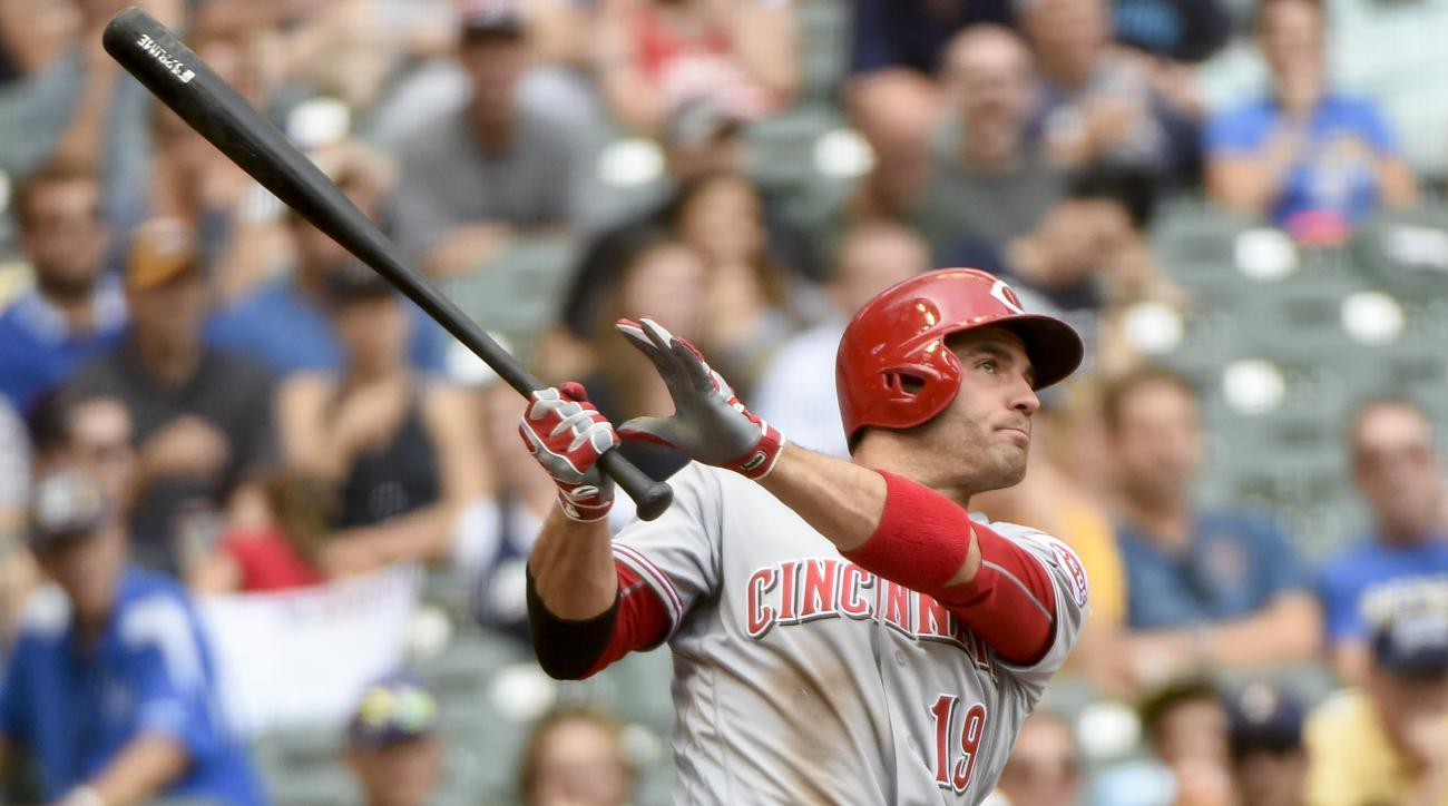 Cincinnati Reds' Joey Votto hits a two-run home run during the eighth inning of a baseball game against the Milwaukee Brewers, Sunday, Aug. 14, 2016, in Milwaukee. (AP Photo/Benny Sieu)