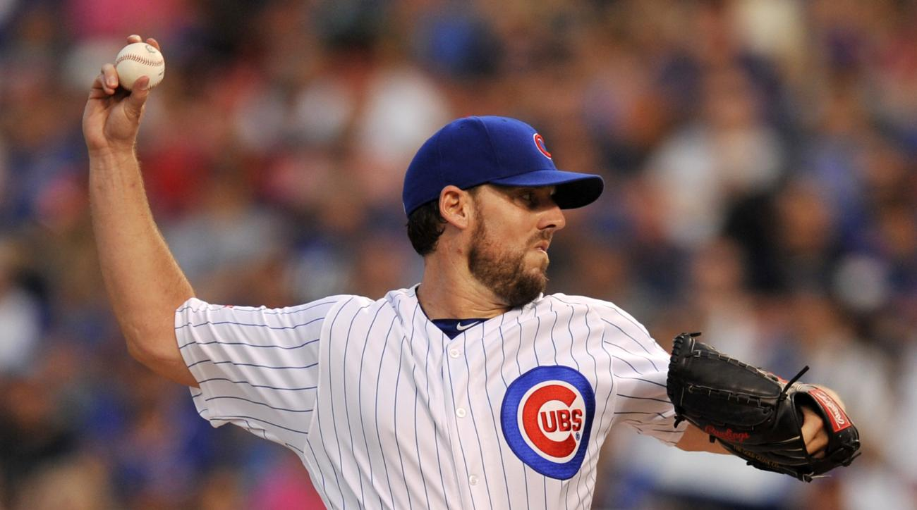 Chicago Cubs starter John Lackey delivers a pitch during the first inning of a baseball game against the St. Louis Cardinals, Sunday, Aug. 14, 2016, in Chicago. (AP Photo/Paul Beaty)
