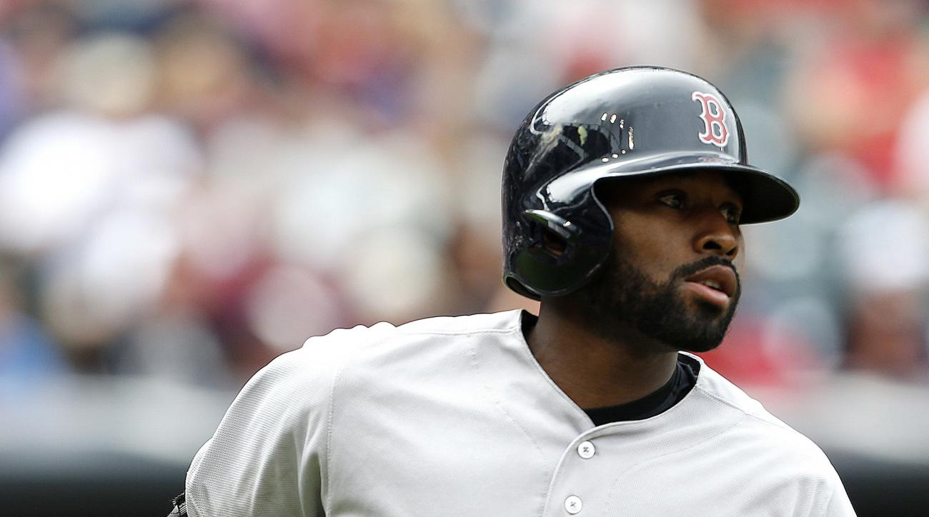 Boston Red Sox's Jackie Bradley Jr. rounds the bases after hitting a solo home run off Cleveland Indians starting pitcher Josh Tomlin during the sixth inning of a baseball game Monday, Aug. 15, 2016, in Cleveland. (AP Photo/Ron Schwane)
