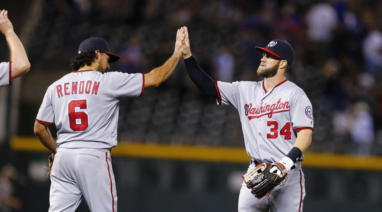Washington Nationals right fielder Bryce Harper (34) celebrates a 5-4 win against the Colorado Rockies during a baseball game, Monday, Aug. 15, 2016, in Denver. (AP Photo/Jack Dempsey)