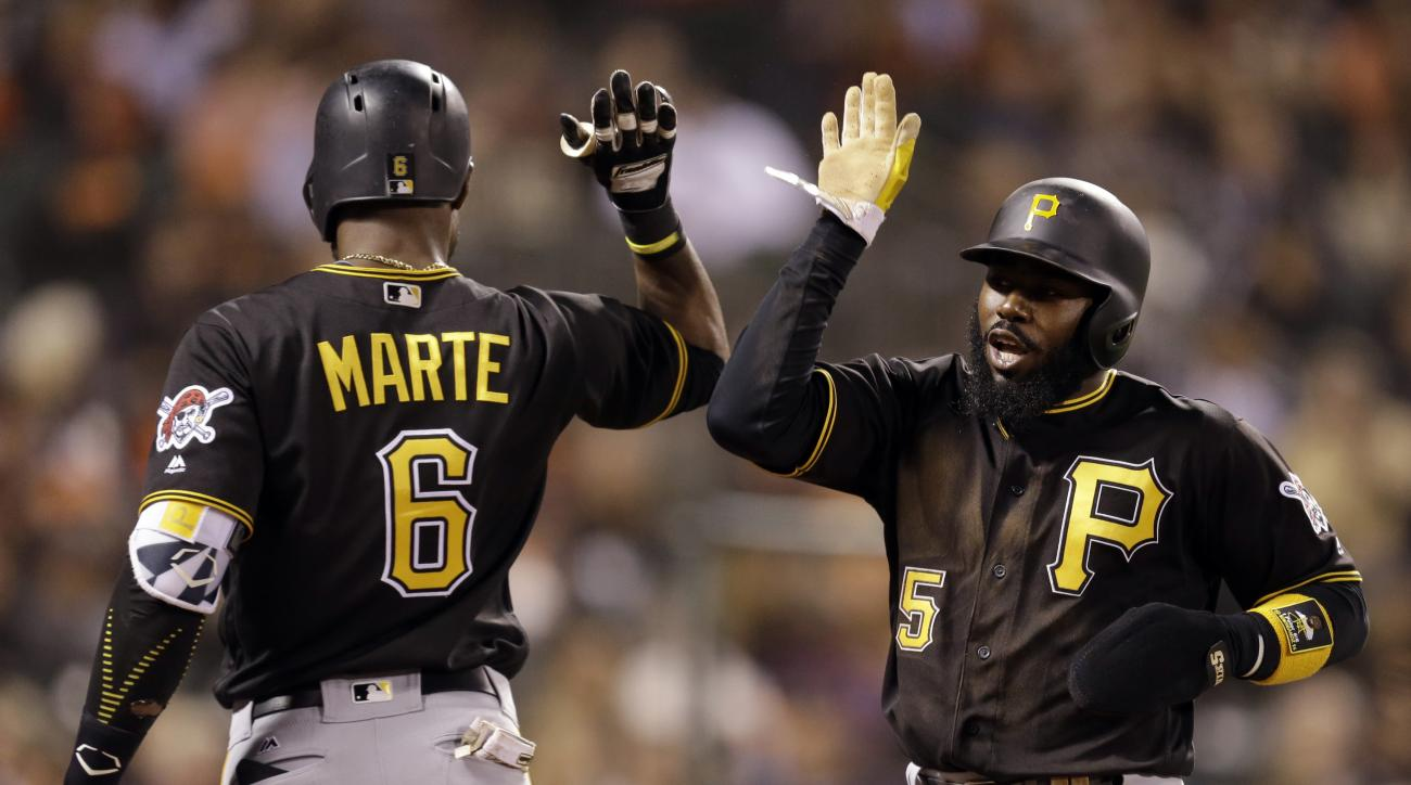 Pittsburgh Pirates' Josh Harrison, right, celebrates with Starling Marte (6) after scoring against the San Francisco Giants in the seventh inning of a baseball game Monday, Aug. 15, 2016, in San Francisco. (AP Photo/Ben Margot)
