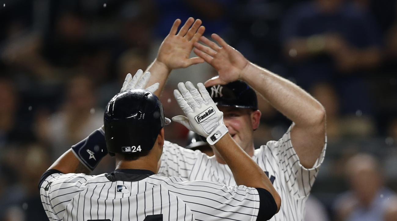 New York Yankees' Brian McCann greets Gary Sanchez (24) after scoring on Sanchez's fourth-inning home run in a baseball game against the Toronto Blue Jays in New York, Tuesday, Aug. 16, 2016. (AP Photo/Kathy Willens)