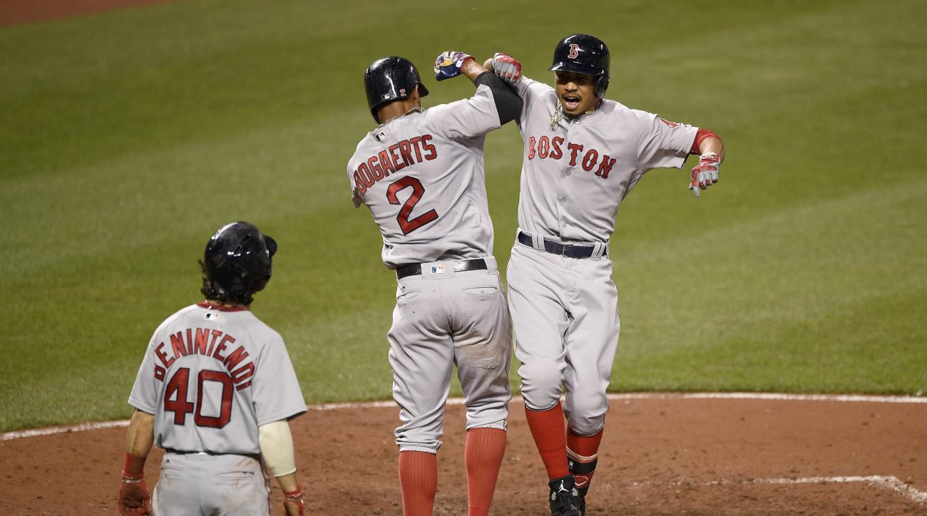 Boston Red Sox's Mookie Betts, right, celebrates his three-run home run with Xander Bogaerts (2) and Andrew Benintendi (40) during the fifth inning of a baseball game against the Baltimore Orioles, Tuesday, Aug. 16, 2016, in Baltimore. (AP Photo/Nick Wass