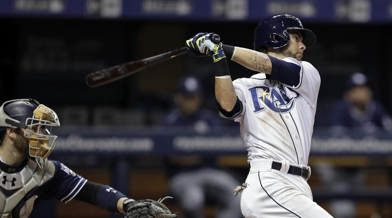 Tampa Bay Rays' Nick Franklin watches his double off San Diego Padres relief pitcher Carlos Villanueva during the seventh inning of a baseball game Tuesday, Aug. 16, 2016, in St. Petersburg, Fla. Catching for the Padres Derek Norris. (AP Photo/Chris O'Mea