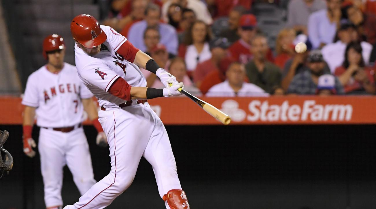 Los Angeles Angels' Jett Bandy hits a solo home run during the sixth inning of a baseball game against the Seattle Mariners, Tuesday, Aug. 16, 2016, in Anaheim, Calif. (AP Photo/Mark J. Terrill)