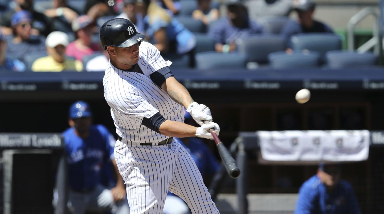 New York Yankees' Gary Sanchez hits a solo home run during the second inning of a baseball game against the Toronto Blue Jays at Yankee Stadium, Wednesday, Aug. 17, 2016 in New York. (AP Photo/Seth Wenig)