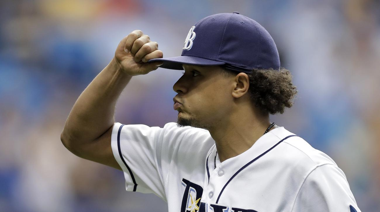 Tampa Bay Rays starting pitcher Chris Archer tips his hat to the crowd as he is taken out of the game against the San Diego Padres during the eighth inning of an interleague baseball game Wednesday, Aug. 17, 2016, in St. Petersburg, Fla. (AP Photo/Chris O