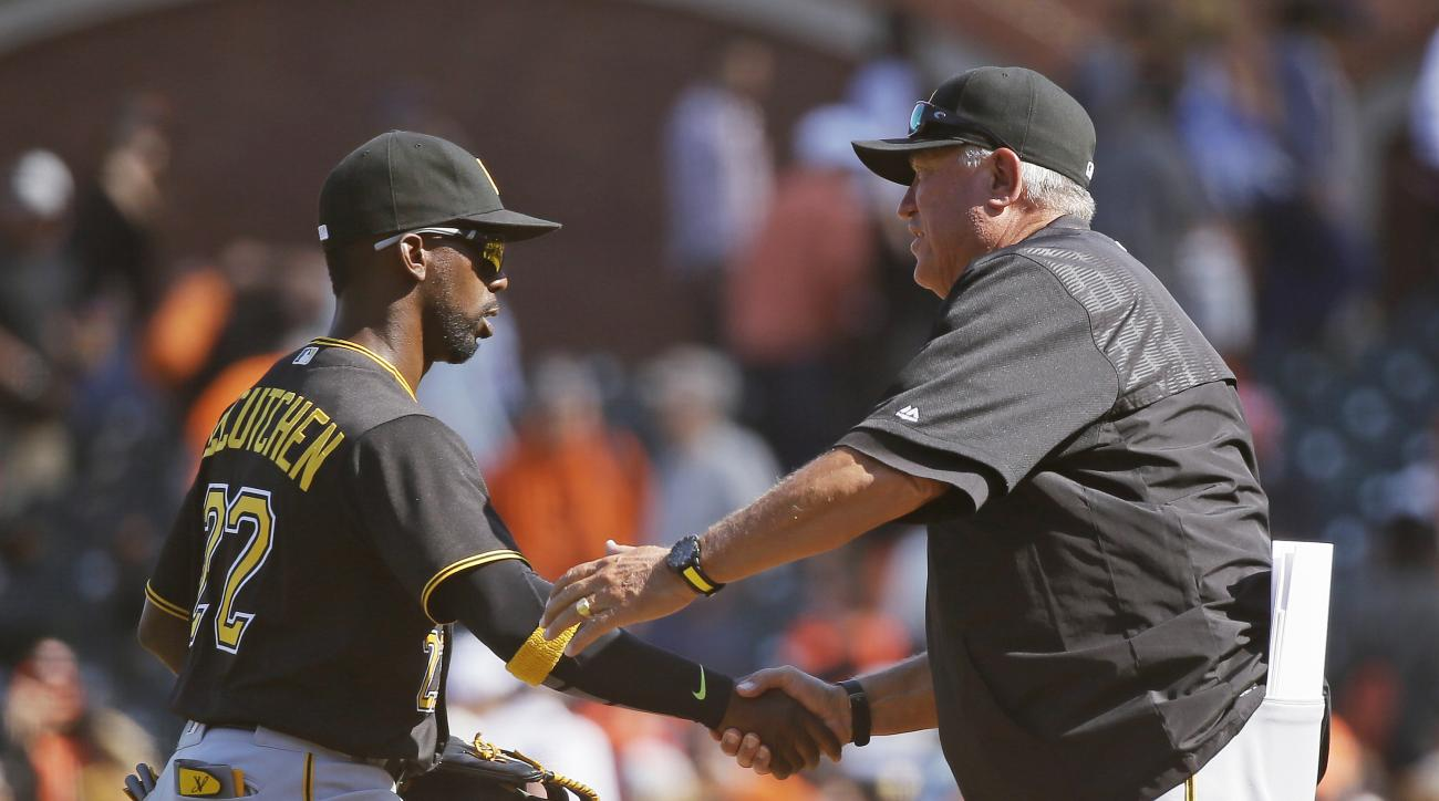 Pittsburgh Pirates center fielder Andrew McCutchen, left, is greeted by manager Clint Hurdle at the end of a baseball game against the San Francisco Giants Wednesday, Aug. 17, 2016, in San Francisco. Pittsburgh won 6-5. (AP Photo/Eric Risberg)