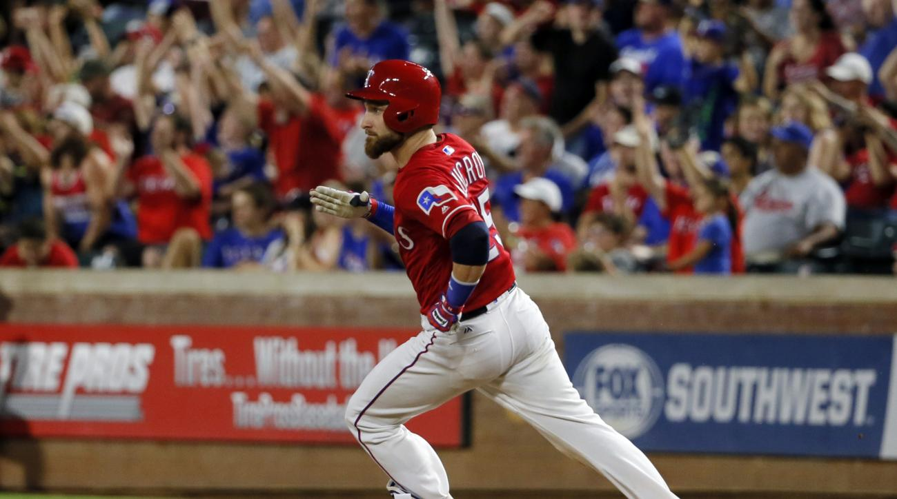 Texas Rangers' Jonathan Lucroy rounds first on his solo home run off of Oakland Athletics' Sean Manaea in the fourth inning of a baseball game, Wednesday, Aug. 17, 2016, in Arlington, Texas. (AP Photo/Tony Gutierrez)