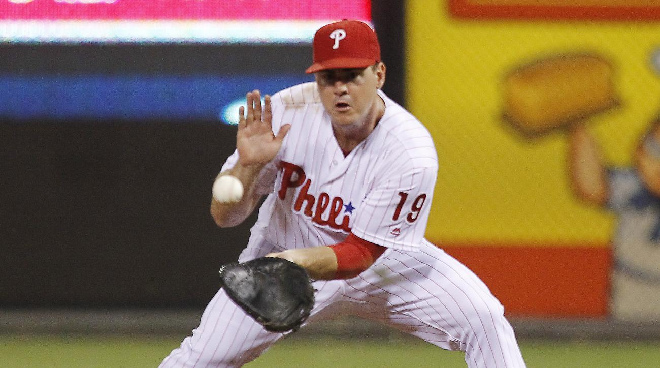Philadelphia Phillies first baseman Tommy Joseph fields a ball hit by Los Angeles Dodgers' Chase Utley before making the out during the fifth inning of a baseball game Wednesday, Aug. 17, 2016, in Philadelphia. (AP Photo/Tom Mihalek)