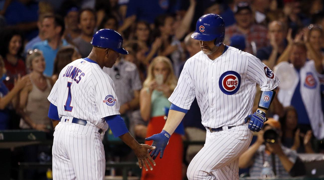 Chicago Cubs' David Ross, right, celebrates with third base coach Gary Jones after hitting a solo home run during the third inning of a baseball game against the Milwaukee Brewers in Chicago, Wednesday, Aug. 17, 2016. (AP Photo/Nam Y. Huh)