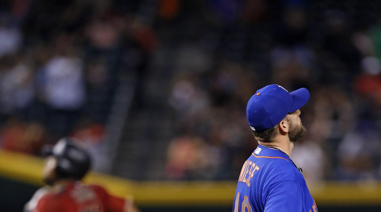 New York Mets' Jonathon Niese (49) pauses on the mound after giving up a home run to Arizona Diamondbacks' Yasmany Tomas, left, during the fourth inning of a baseball game Wednesday, Aug. 17, 2016, in Phoenix. (AP Photo/Ross D. Franklin)