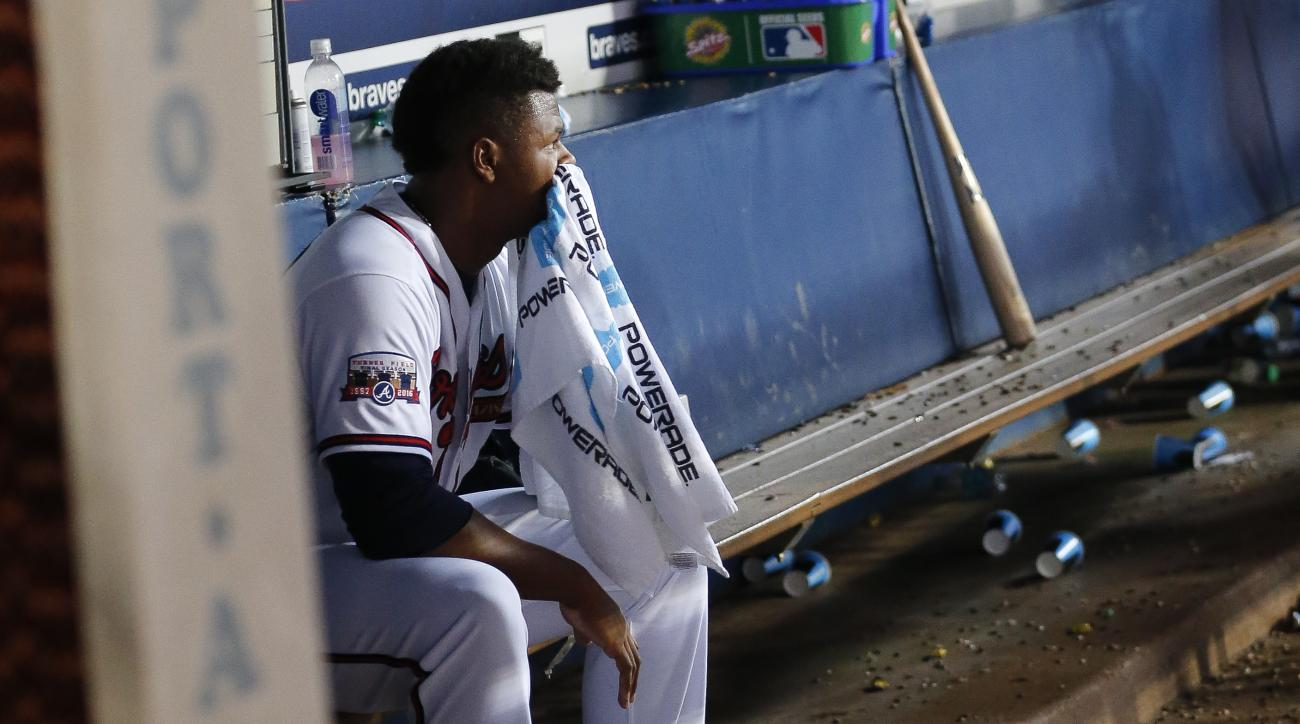 CORRECTS TO FIVE RUNS ALLOWED, INSTEAD OF FOUR - Atlanta Braves relief pitcher Mauricio Cabrera sits on the bench after the Braves allowed five runs to the Washington Nationals during the eighth inning of a baseball game in Atlanta, Thursday, Aug. 18, 201