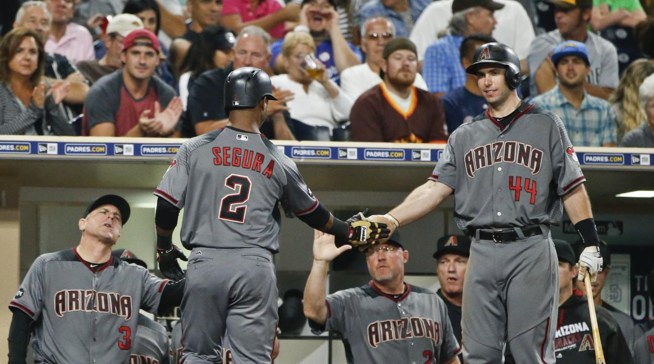 Arizona Diamondbacks' Jean Segura is congratulated by Paul Goldschmidt , right, after hitting a two-run home run against the San Diego Padres during the sixth inning of a baseball game Thursday, Aug. 18, 2016, in San Diego. (AP Photo/Lenny Ignelzi)